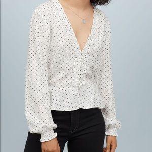 Long sleeved v-neck white ruffled top.